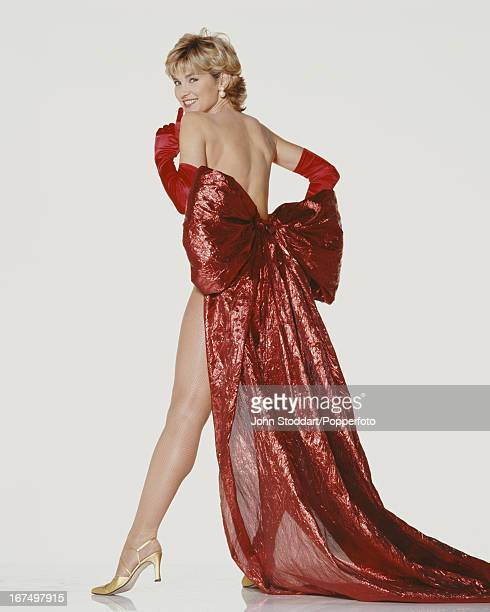 English television presenter Anthea Turner wearing a red dress 1996