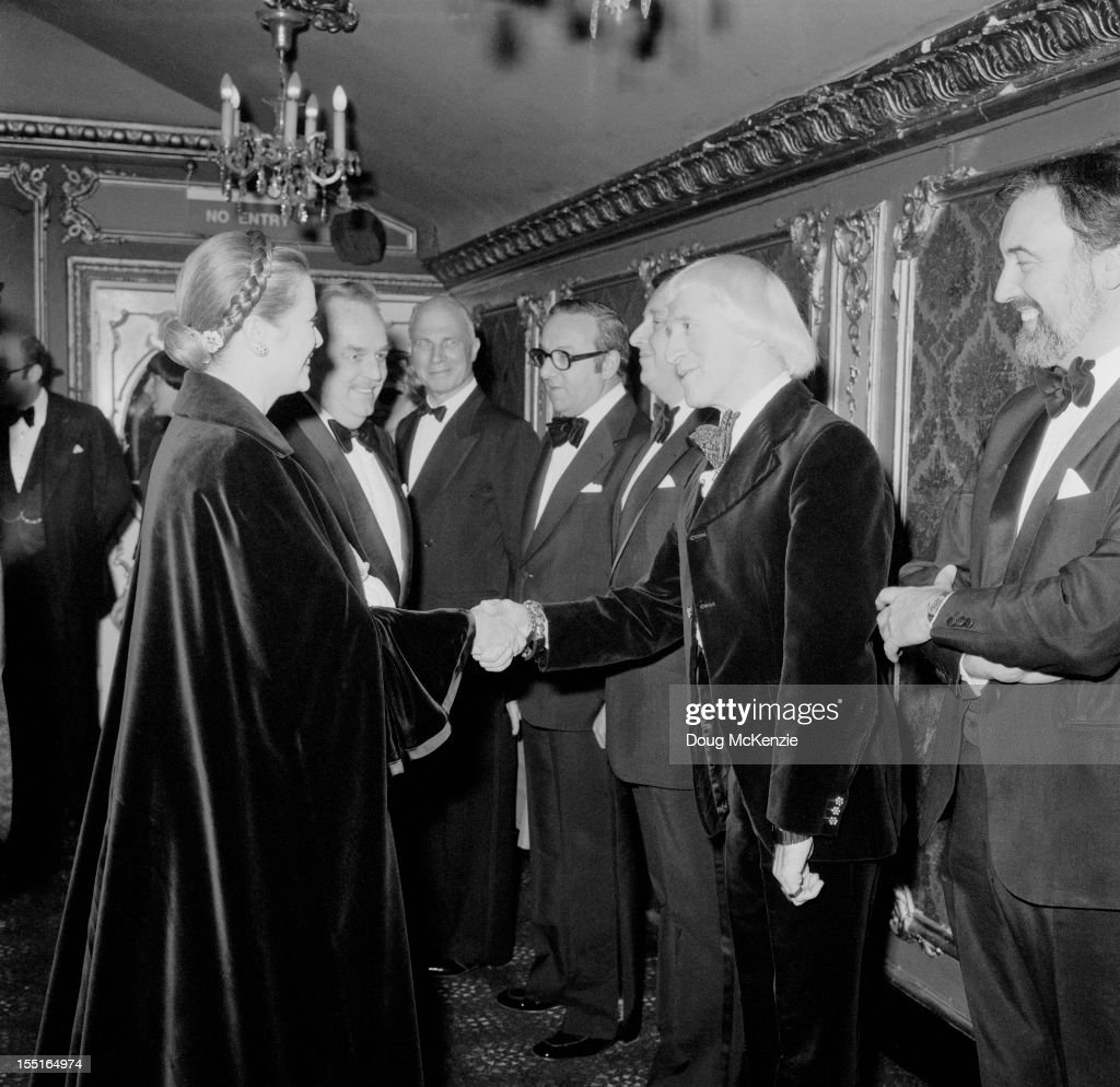 English television presenter Jimmy Savile (1926 - 2011) meets Prince Rainier III (1923 - 2005) and Princess Grace of Monaco (1929 - 1982), circa 1980.