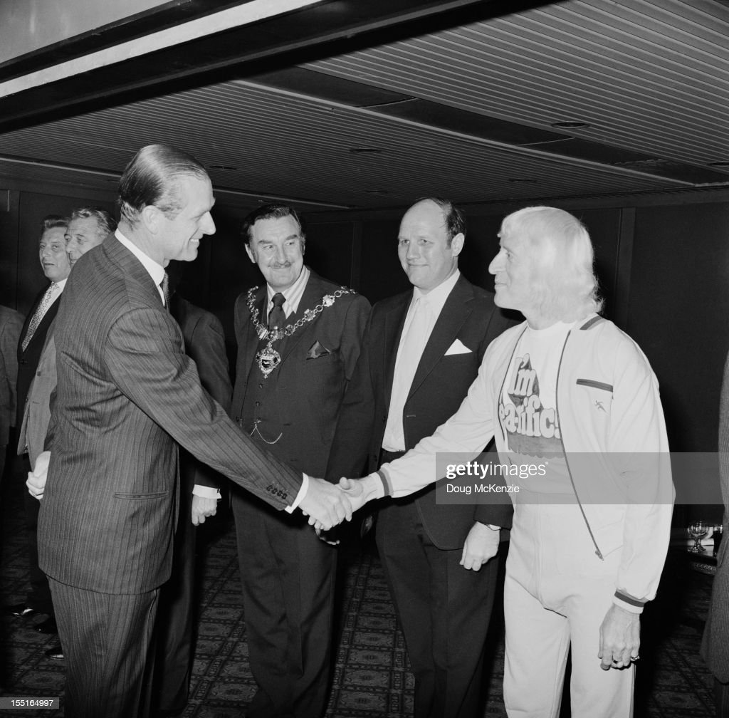 English television presenter Jimmy Savile (1926 - 2011) meets the Duke of Edinburgh during a Variety Club of Great Britain charity walk luncheon, 19th April 1973.