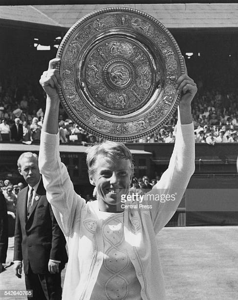 English tennis player Ann Jones holds the trophy after beating Billie Jean King of the USA in the final of the Ladies' Singles at the Wimbledon Lawn...