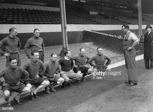 English tennis player Fred Perry training with Arsenal footballers at their Highbury ground London 21st February 1936 Front left to right Denis...