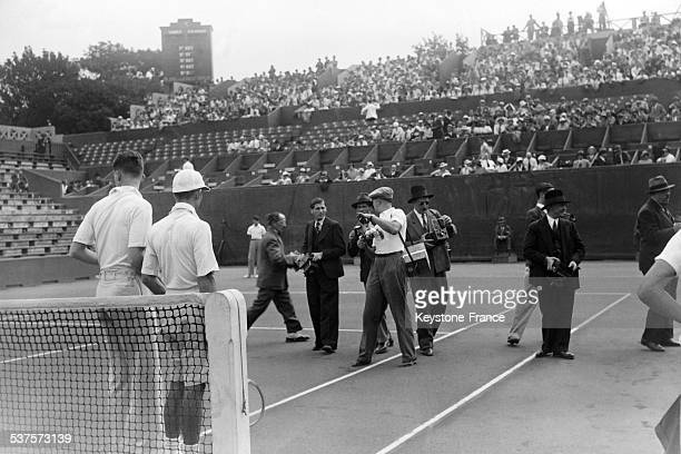 English tennis player Henry Austin and American tennis player Ellsworth Vines posed for journalists at the first match EnglandUnited States of the...