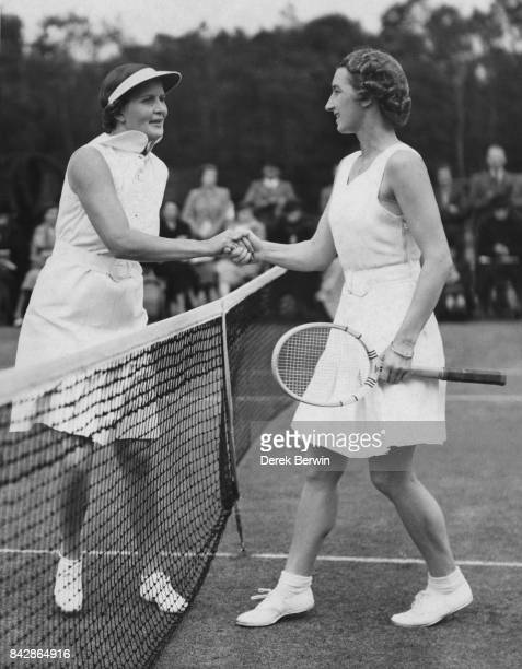 English tennis player Mary Hardwick congratulates South Africa's Bobbie Heine Miller on her win in the semifinals of the St George's Hill Club Tennis...