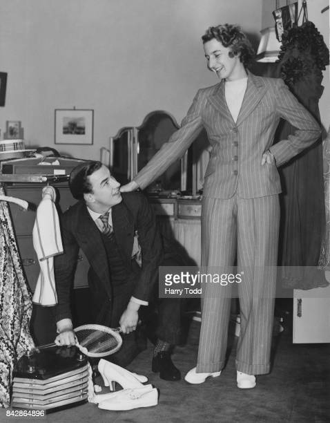 English tennis player Mary Hardwick packs for a trip to Jamaica with the help of her brother Derek UK 15th January 1939 She will be taking part in...