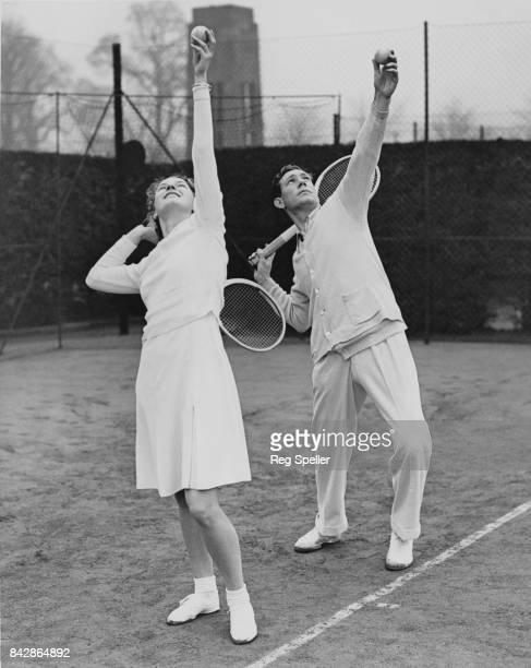 English tennis player Mary Hardwick takes lessons from AllEngland coach Dan Maskell on the hard courts at Wimbledon London 11th December 1935 The...