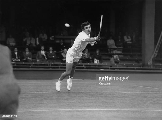 English tennis player Stanley Matthews in play against Ismail El Shafei of Egypt in a first round match in the Men's Singles at the Wimbledon...