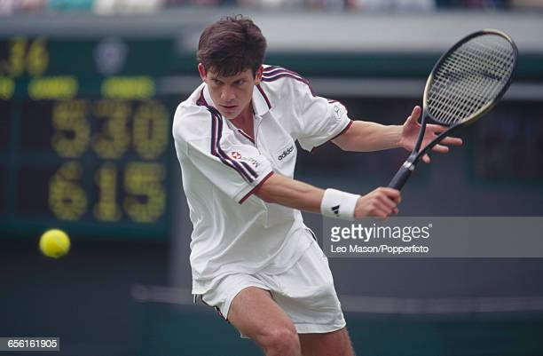 English tennis player Tim Henman pictured in action during competition to reach the quarterfinals of the Men's Singles tournament at the Wimbledon...