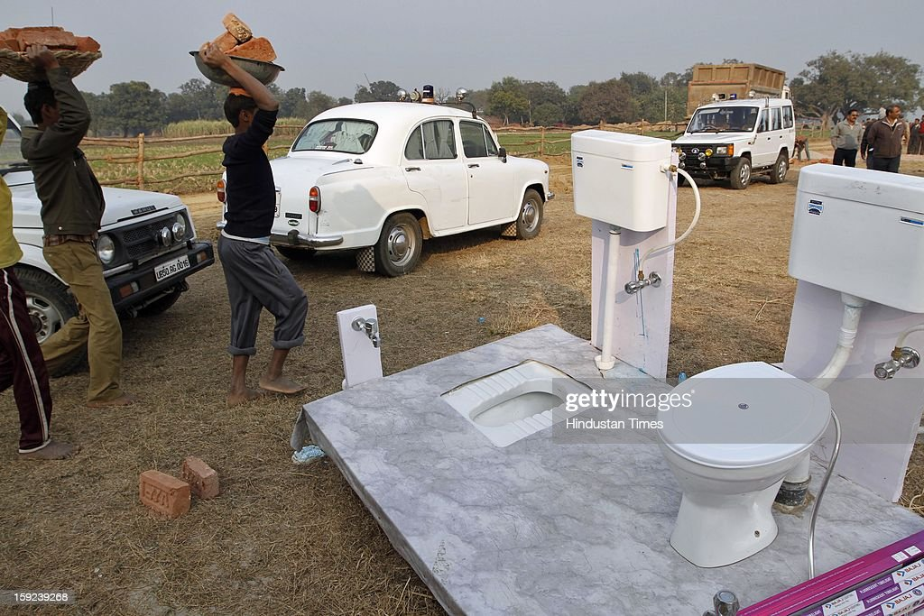 English Toilet being set up ahead of Chief Minister Akhilesh Yadav's visit to native village of Delhi Gang Rape victim on January 10, 2013 in Ballia, India. Uttar Pradesh administration is working overtime to prepare for Chief Minister Akhilesh Yadav's expected visit on January 12 to give a cheque to the father of the gangrape victim who died in Singapore after being brutally raped and tortured on a bus.