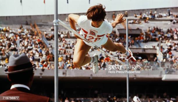 English track and field athlete Barbara Inkpen competes wearing odd coloured running shoes to finish in 13th place in the Women's high jump event at...