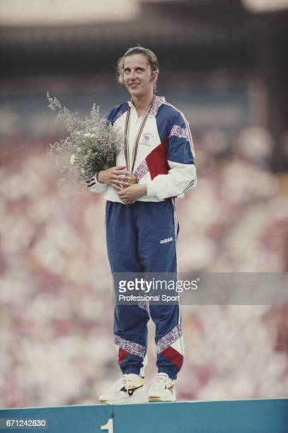 English track and field athlete Sally Gunnell of the Great Britain team stands on the medal podium after finishing in first place to win the gold...