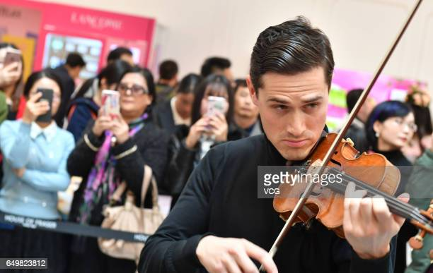 English violinist Charlie Siem performs at a shopping mall on International Women's Day on March 8 2017 in Nanjing Jiangsu Province of China