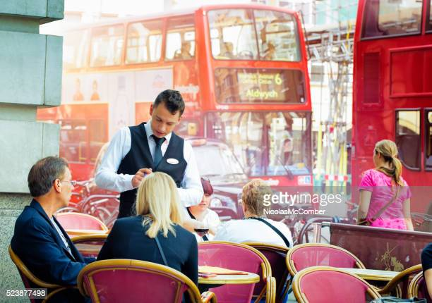 English waiter taking orders at London Cafe