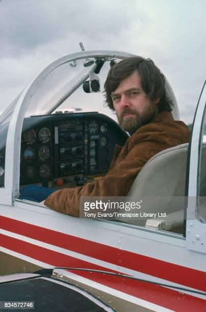 English wildlife photographer and author Stephen Dalton on a plane March 1978