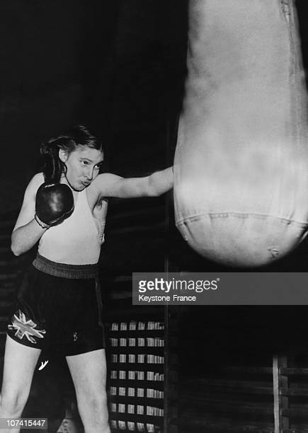 English Woman Boxer Barbara Buttrick Training Against Sand Bag On