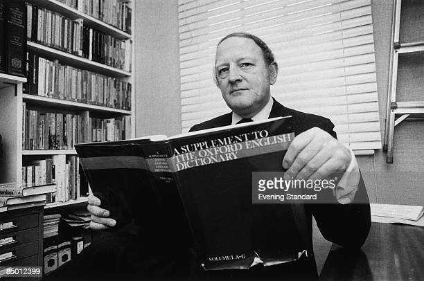 English writer and broadcaster Robert Robinson holding the first volume of 'A Supplement To The Oxford English Dictionary' 24th March 1977