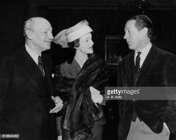 English writer Laurie Lee with Clement Attlee and Moira Lister at the Foyles Literary Luncheon at the Dorchester Hotel London 16th March 1956 Lee had...
