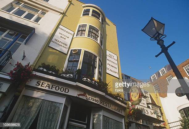 English's Oyster bar and seafood restaurant in Brighton's lanes advertising a selection of freshly caught seafood including lobster prawns mussels...