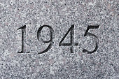 Historical year engraving 1945 on textured old surface