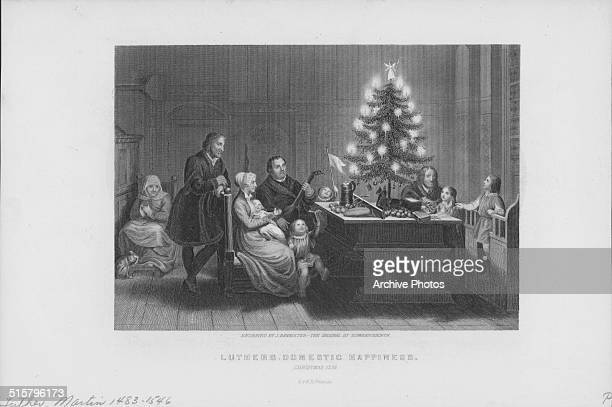 Engraved portrait of religious reformer Martin Luther and his family a picture of domestic happiness around a Christmas tree 1536 Engraved by J...