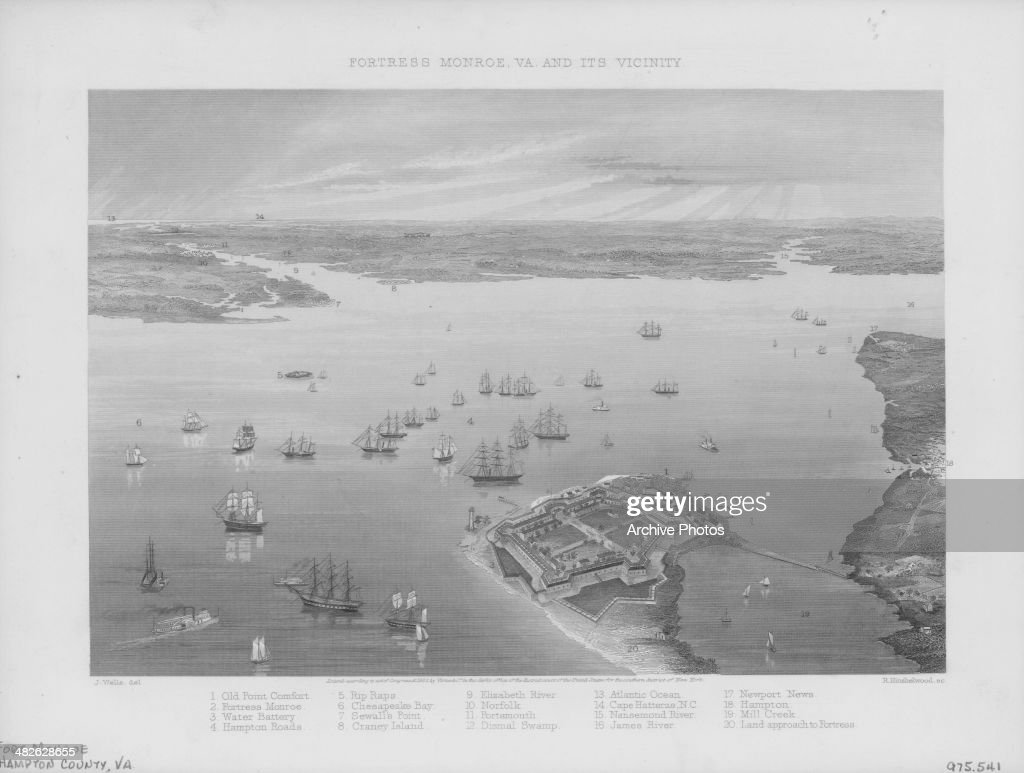 Engraved view of Fort Monroe surrounded by ships a military stone fortification at Old Point Comfort in Chesapeake Bay Virginia circa 18301850...