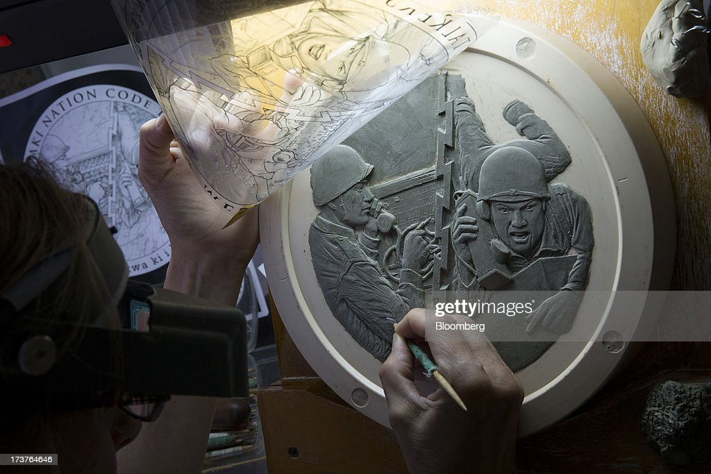 Engraver Phebe Hemphill works on a plaster model for a congressional gold medal at the U.S. Mint in Philadelphia, Pennsylvania, U.S., on Wednesday, July 17, 2013. Some sources of declining inflation 'are likely to be transitory' and expectations for future price increases 'have generally remained stable,' Ben S. Bernanke, chairman of the U.S. Federal Reserve said in prepared remarks. Photographer: Scott Eells/Bloomberg via Getty Images