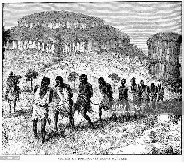 Engraving depicts a forced march of men and women on their way to slave ships Africa 1820s Men hired by Portuguese slave traders tied their hands and...