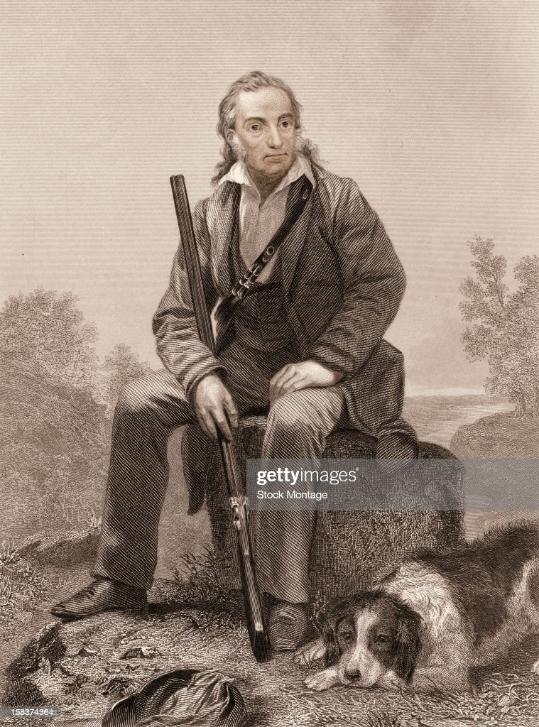 Engraving portrait of American ornithologist and artist John James Audubon as he sits on a rock a rifle in one hand and a dog at his feet early 19th...