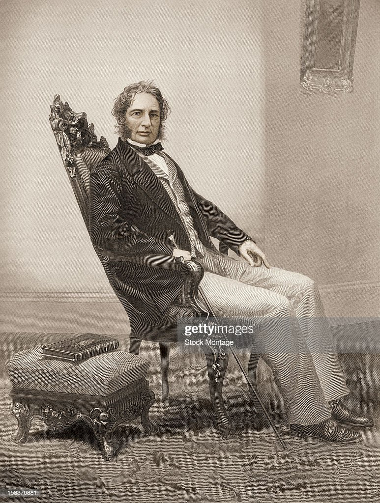 Engraving portrait of American poet Henry Wadsworth Longfellow as he sits on a chair mid 19th century