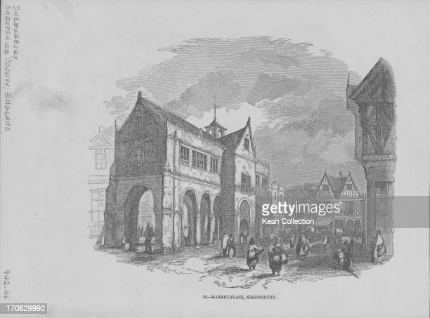 Engraving showing the view of Old Market Hall and bustling activity in the Square Shrewsbury UK circa 18001890