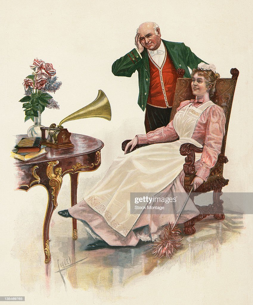 Engraving shows a man and a woman as they listen to a a phonograph late 1800s or early 1900s