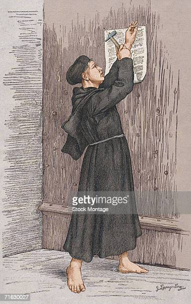 Engraving shows German theologian Martin Luther as he nails the 'Disputation of Martin Luther on the Power and Efficacy of Indulgences' to the church...
