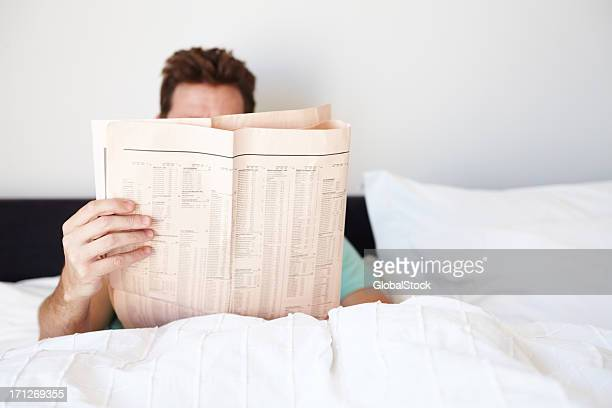 Engrossed in his morning paper