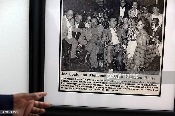 Enid Curtis Pinkney Founding President and CEO of the Historic Hampton House Community Trust points to a photograph of boxers Joe Louis and Mohammad...