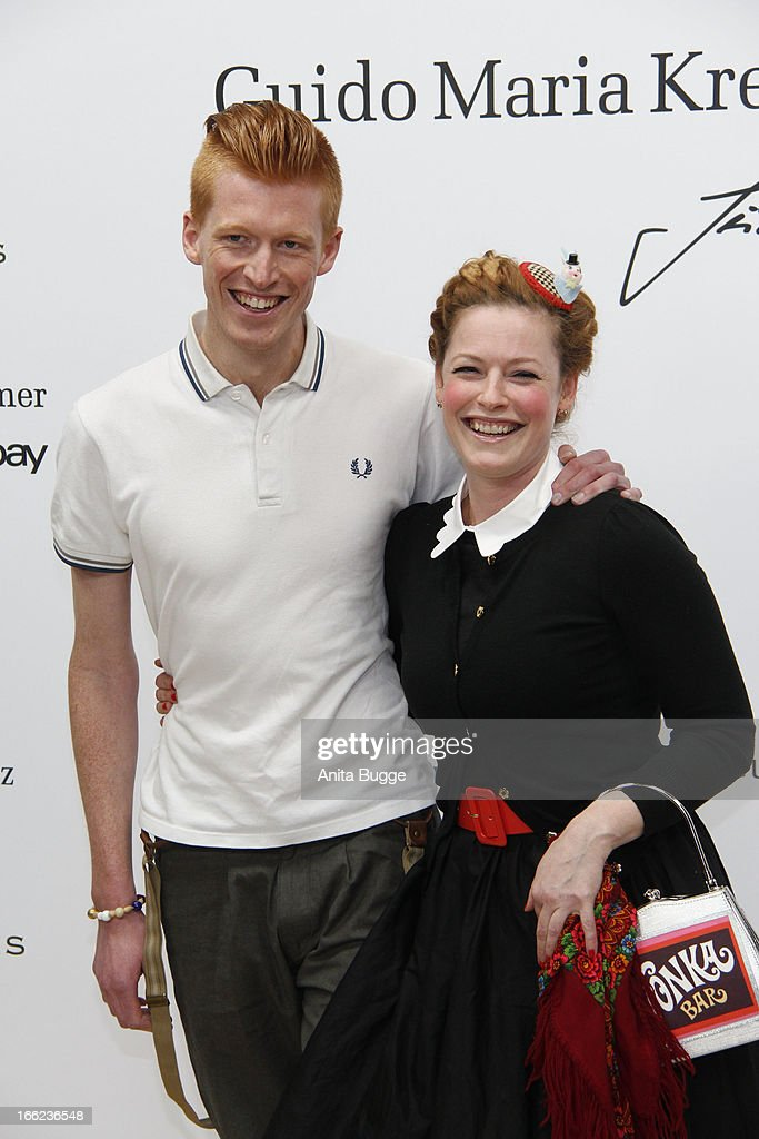 Enie van de Meiklokjes (R) and Tobias Staerbo attend the Guido Maria Kretschmer For eBay Collection Launch at Label 2 on April 10, 2013 in Berlin, Germany.