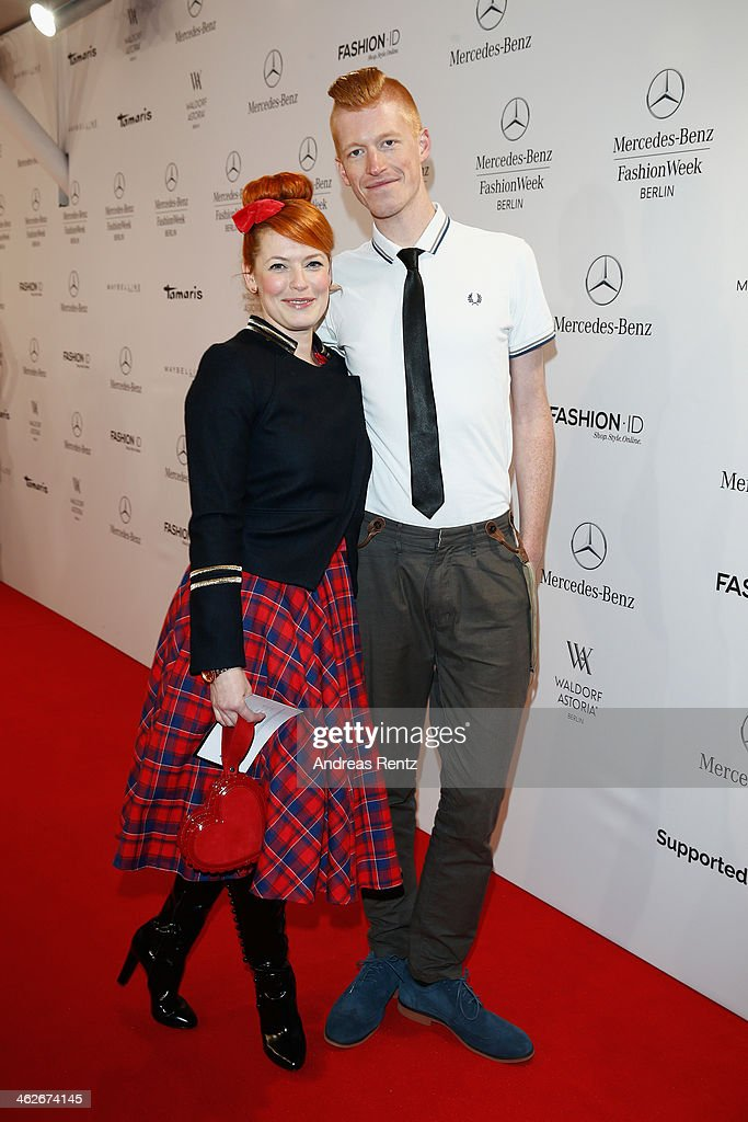 Enie van de Meiklokjes and Tobias Staerbo attend the Riani show during Mercedes-Benz Fashion Week Autumn/Winter 2014/15 at Brandenburg Gate on January 14, 2014 in Berlin, Germany.