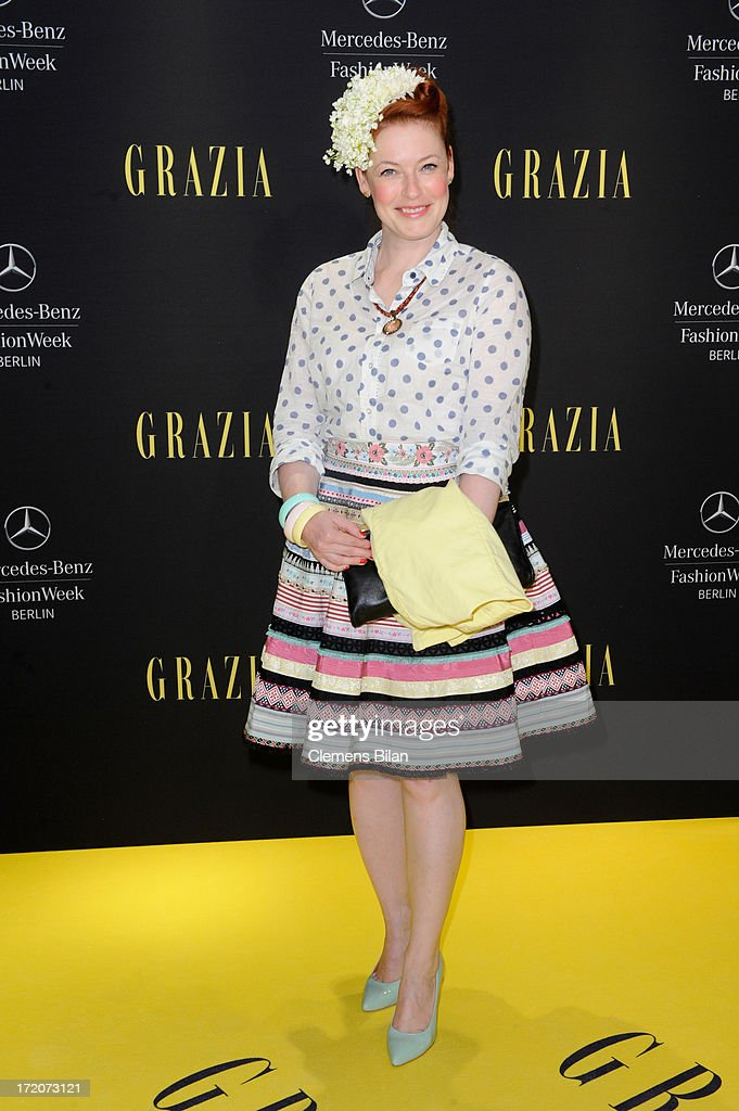 Enie van de Meiklokjes attends the Mercedes-Benz Fashion Week Berlin Spring/Summer 2014 Preview Show by Grazia at the Brandenburg Gate on July 1, 2013 in Berlin, Germany.