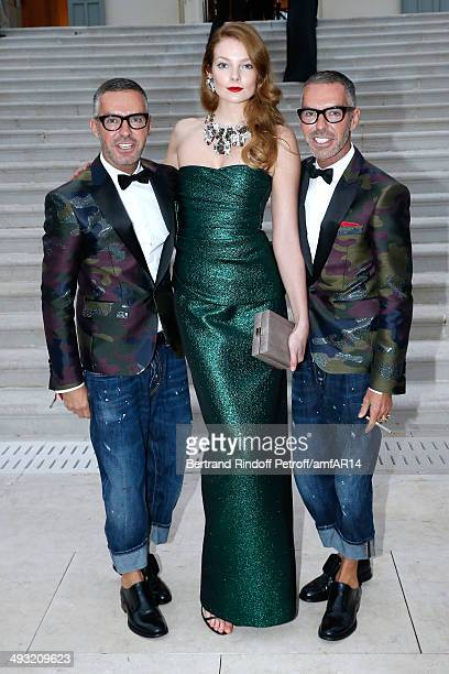 Eniko Mihalik standing between Dean Caten and Dan Caten attend amfAR's 21st Cinema Against AIDS Gala Presented By WORLDVIEW BOLD FILMS And BVLGARI at...