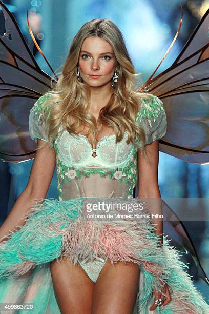 Eniko Mihalik walks the runway at the annual Victoria's Secret fashion show at Earls Court on December 2 2014 in London England