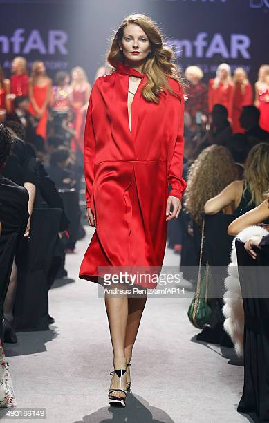 Eniko Mihalik walks the runway during amfAR's 21st Cinema Against AIDS Gala Presented By WORLDVIEW BOLD FILMS And BVLGARI at Hotel du CapEdenRoc on...
