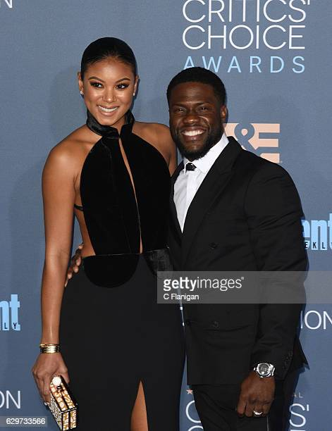 Eniko Parrish and actor Kevin Hart attend The 22nd Annual Critics' Choice Awards at Barker Hangar on December 11 2016 in Santa Monica California t
