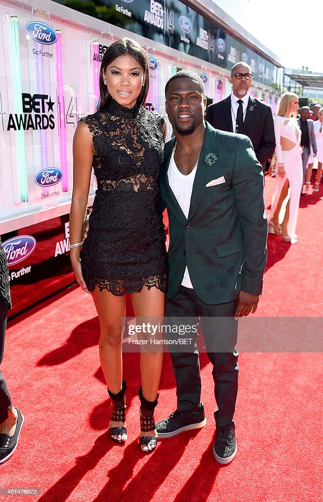 Eniko Parrish (L) and actor Kevin Hart attends the BET AWARDS '14 at Nokia Theatre L.A. LIVE on June 29, 2014 in Los Angeles, California.