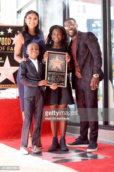 Eniko Parrish Hendrix Hart Heaven Hart and honoree Kevin Hart pose for a photo as Kevin Hart is honored with a star on the Hollywood Walk of Fame on...