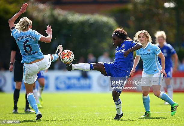Eniola Aluko of Chelsea challenges with Steph Houghton of Manchester City during the SSE Women's FA Cup Semifinal match between Chelsea Ladies FC v...