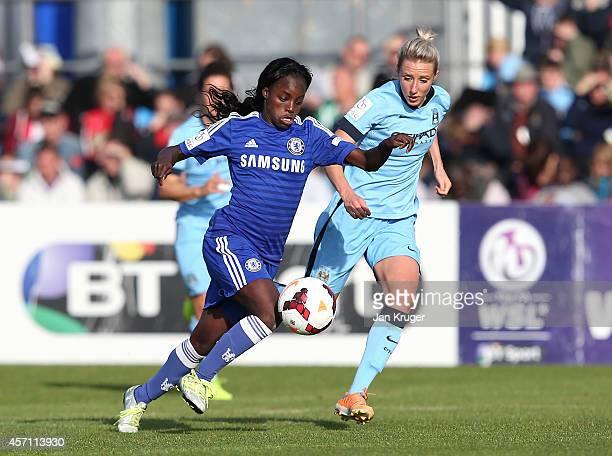 Eniola Aluko of Chelsea Ladies battles with Emma Lipman of Manchester City Women during the WSL match between Manchester City Women and Chelsea...