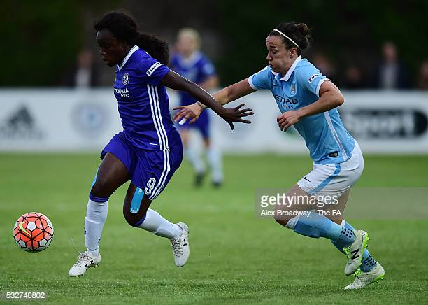 Eniola Aluko of Chelsea Ladies FC and Lucy Bronze of Manchester City Women vie for the ball during the FA WSL 1 match between Chelsea Ladies FC and...