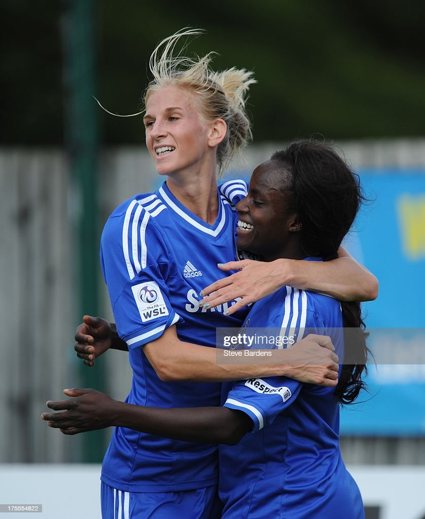 <a gi-track='captionPersonalityLinkClicked' href=/galleries/search?phrase=Eniola+Aluko&family=editorial&specificpeople=234686 ng-click='$event.stopPropagation()'>Eniola Aluko</a> of Chelsea Ladies FC (R) celebrates scoring a goal with teammate <a gi-track='captionPersonalityLinkClicked' href=/galleries/search?phrase=Sofia+Jakobsson&family=editorial&specificpeople=7097023 ng-click='$event.stopPropagation()'>Sofia Jakobsson</a> during the FA Women's Super League match between Chelsea Ladies FC and Doncaster Rovers Belles Ladies FC at the Wheatsheaf Stadium on August 4, 2013 in Staines, England.