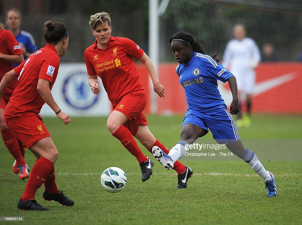 <a gi-track='captionPersonalityLinkClicked' href=/galleries/search?phrase=Eniola+Aluko&family=editorial&specificpeople=234686 ng-click='$event.stopPropagation()'>Eniola Aluko</a> of Chelsea passes the ball past Lucy Bronze of Liverpool during the FA WSL match batween Chelsea Ladies FC and Liverpool Ladies FC at Wheatsheaf Park on May 12, 2013 in Staines, England.