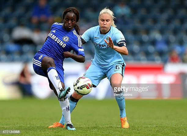 Eniola Aluko of Chelsea passes under pressure from Steph Houghton of Manchester City during the Women's FA Cup Semi Final match between Chelsea...
