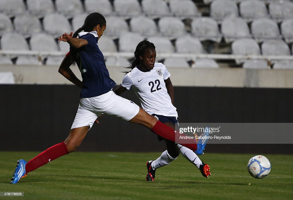 Eniola Aluko (R) of England and Wendie Renard of France in action during the Cyprus cup final between England an France at GSP stadium on March 12, 2014 in Nicosia, Cyprus.