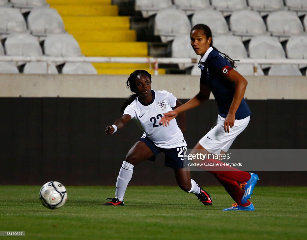 Eniola Aluko (L) of England and Wendie Renard of France in action during the Cyprus cup final between England an France at GSP stadium on March 12, 2014 in Nicosia, Cyprus.